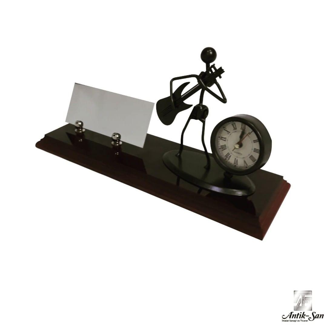 müzikal figürlü saatli masa isimliği